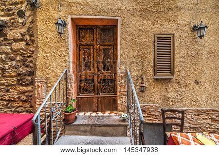 wooden door in a picturesque corner in Sardinia Italy