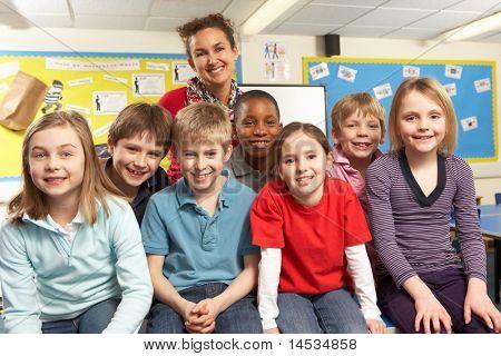 School Children In Classroom With Teacher