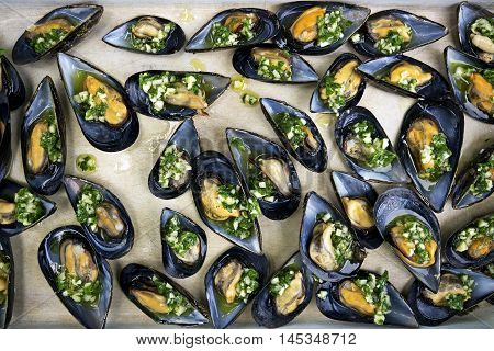 Fresh mussels with garlic parsley and olive oil close up