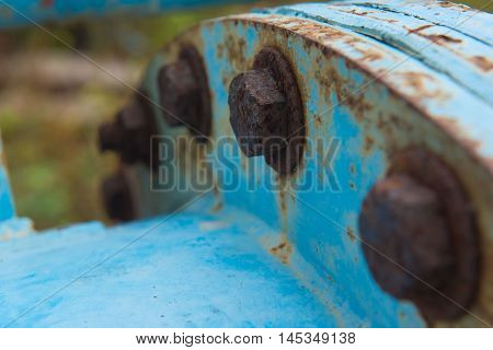 closeup Big rusty metal Screws and nuts locked with rust