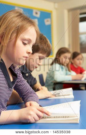 Group Of School Children Working In Classroom