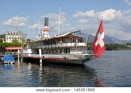 LUCERNE SWITZERLAND - MAY 04 2016: Wilhelm Tell steamship built in 1908 then restored to its original splendor nowadays is permanently anchored and invites on board to the well known restaurant