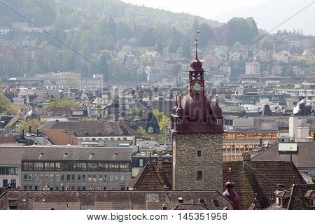 LUCERNE SWITZERLAND - MAY 04 2016: Clock tower it is a part Town Hall that was built in the early 1600s. High at over 40 meters Clock Tower towering over the houses of the old town