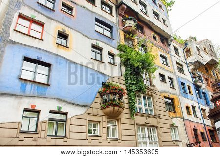 VIENNA, AUSTRIA - JUN 12, 2016: Original architectural project of building with concept of Austrian artist Hundertwasser on June 12, 2016. Hundertwasserhaus built at 1985 and became the cultural heritage