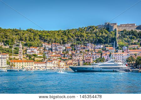 Waterfront view at famous touristic town Hvar on Adriatic sea, Croatia summertime, Europe.