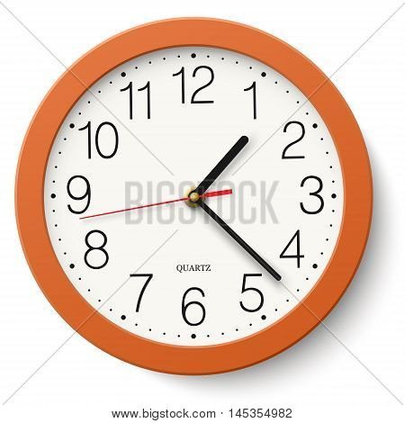 Classic round wall clock in orange body isolated on white background