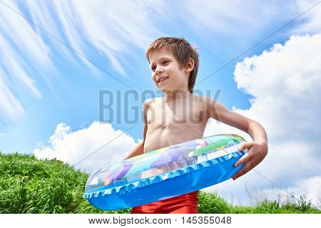 Happy Boy With Toy Lifebuoy For Swimming In Summer Day