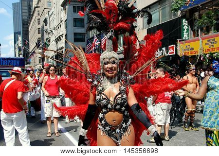 New York City - June 28, 2009: Marcher wearing an elaborate feather costume at the 40th anniversary gay pride parade on Fifth Avenue
