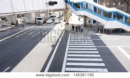 Osaka, Japan - march 2015: Business concept street view of Japanese businessman crossing the traffic junction
