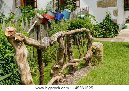 handmade creative and original wooden fence made of logs