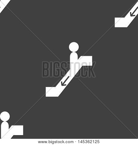 Escalator Down Icon Sign. Seamless Pattern On A Gray Background. Vector