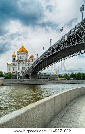 Moscow view. Architecture Moscow landscape - Cathedral of Christ the Saviour and Patriarshy bridge in summer cloudy day in Moscow Russia. Summer view of Moscow architecture landmark.