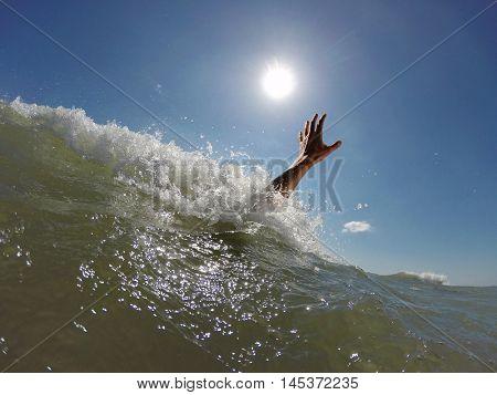 Hand drowning man