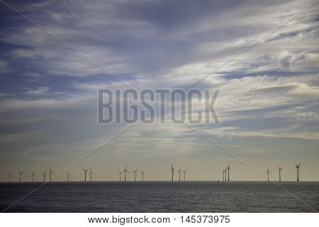 The subtle subdued nature of this picture reflects the ethos of sustainable energy. Whispy clouds lead the viewer towards the turbines on the horizon.