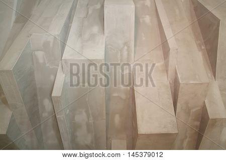 Concrete decorative art grey geometric wall in modern studio