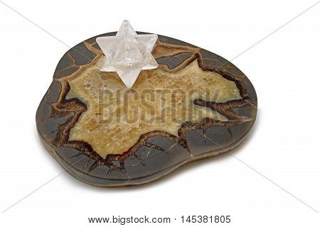 Merkabah and Septarian Crystals - A large slice of Septarian concretion geode with a large white quartz Merkabah crystal positioned on top isolated on white background