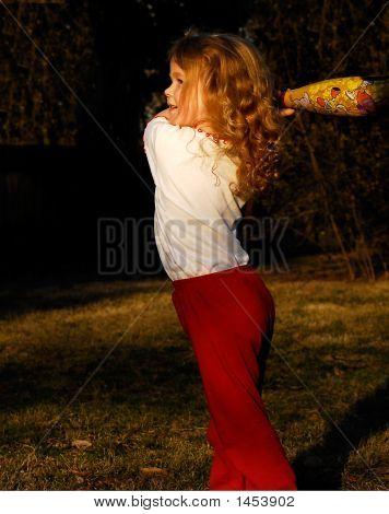 Girl Playing Basesball