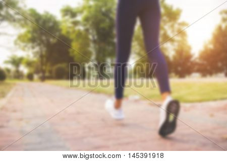 blurred backgrounds of people exercise at parks outdoor:blur of people runningwalkingjogging at park:blur of nature park outdoor:blur and out of focus concept:blurred of sport and activity concept.