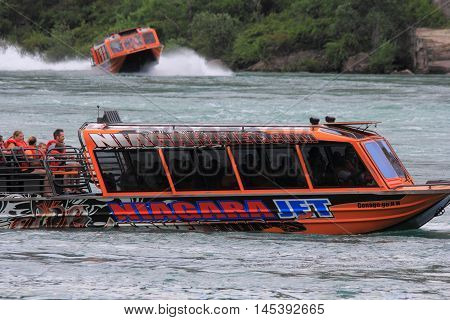 NIAGARA FALLS, CANADA. JULY 15, 2016. Niagara Jet Boats are a popular attraction that's sure to thrill and excite as you shoot the rapids of the mighty Niagara River.