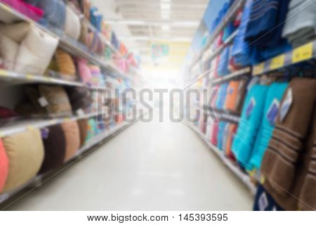 abstract blurred shelf of pillow and towel on the department store.