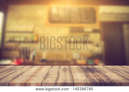 Wood Table Top On Blur Background Of Coffee Shop (or Restaurant) Interior - Can Be Used For Display