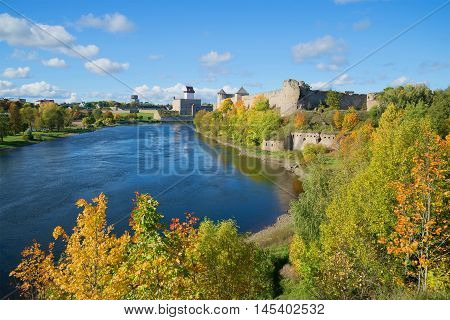 Sunny september day on the border river Narva. Look at the Russian Ivangorod fortress and the Estonian Hermann castle