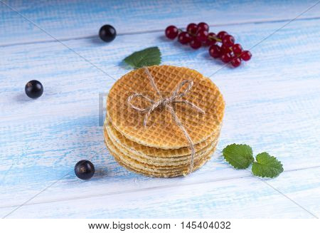 Stack Of Dutch Caramel Waffles. Strack Of Traditional Dutch Waffle Called Stroopwafel On Blue Backgr