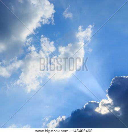 Sunbeam Of Sunlight Through Clouds On Clear Blue Sky