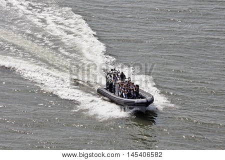 DEN HAAG, NETHERLANDS - JUNE 4: A ride on a speed boat it is possible to pay in the beach district Scheveningen in Den Haag on June 4 2016