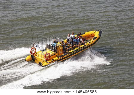DEN HAAG NETHERLANDS - JUNE 4: A ride on a speed boat it is possible to pay in the beach district Scheveningen in Den Haag on June 4 2016