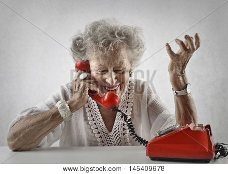 Chatty elderly woman doing a phone call