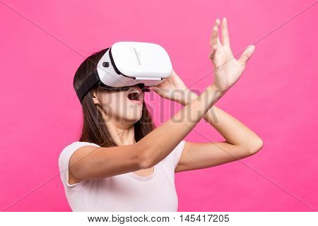 Asian Woman looking though virtual reality device