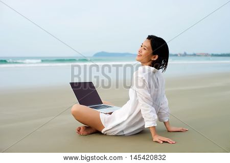 Girl Relax With Laptop At Beach