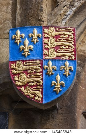 The Royal Standard or Coat of Arms on the exterior of All Souls College - one of the historic colleges of the University of Oxford England.
