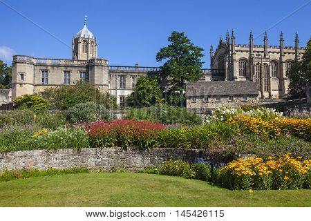 The view of Christ Church College from Christ Church Memorial Garden in Oxford England. Tom Tower can be seen on the left-handside.