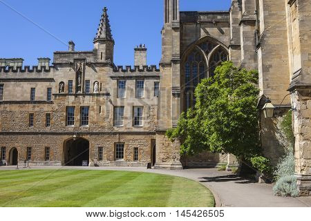 A view inside a courtyard at New College in Oxford England. It is one of the historic constituent colleges of Oxford University and where some scenes of the Harry Potter movies were filmed.