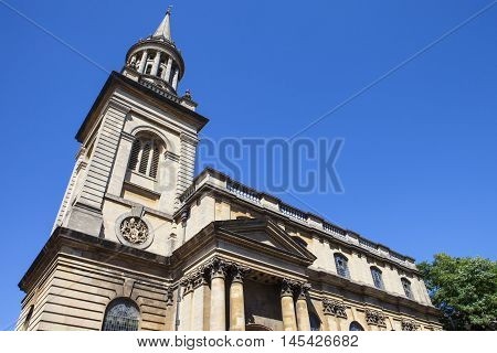 Looking up the exterior of All Saints Church in Oxford. It now houses the library for Lincoln College - one of the historic colleges of Oxford University.