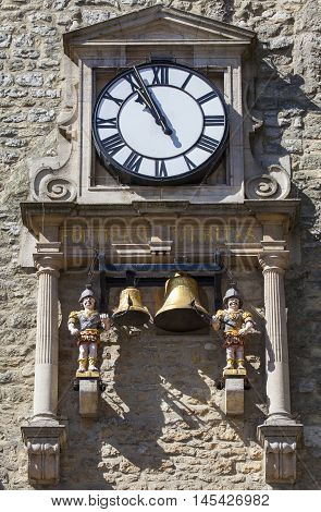 The clock and chiming quarter boys of St. Martins Tower popularly known as Carfax Tower in Oxford England.
