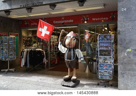 LUCERNE SWITZERLAND - MAY 2 2016: Casi Boy mascot created in 1959 advertises Casagrande gift store belonging to the created in 1948 the company that since 1950 sells souvenirs known among tourists