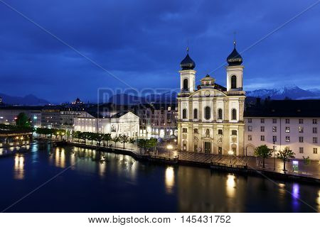 Lucerne Switzerland - May 03 2016: Night view towards the Jesuit Church located by the river Reuss in old town. It is widely believed to be the most beautiful Baroque church in Switzerland.