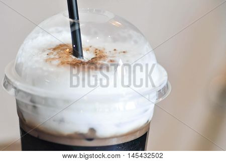 glass of iced cocoa or iced chocolate