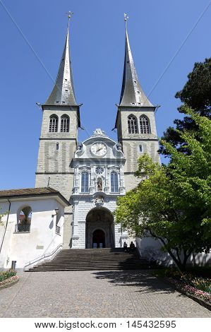 LUCERNE SWITZERLAND - MAY 06 2016: The front view of the Church of St. Leodegar that was built from 1633 to 1639. It is a recognizable landmark in the city
