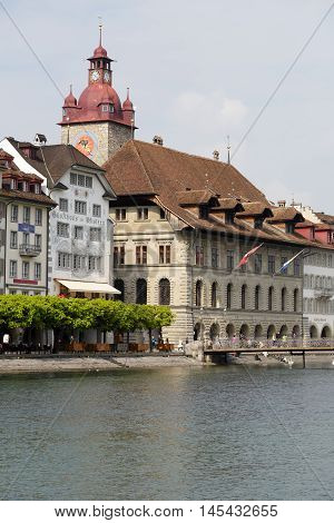 LUCERNE SWITZERLAND - MAY 02 2016: Town Hall was built in the early 1600s it is impresive building together with its tower is located down by the river Reuss.
