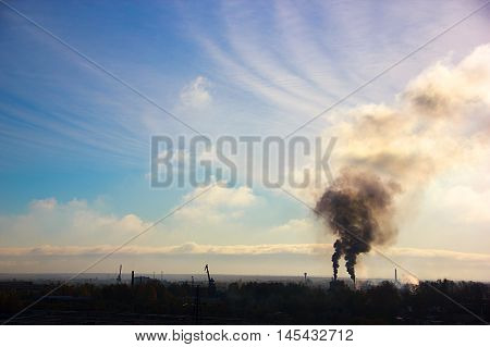 black smoke from the chimneys urban landscape. black smoke from industrial chimneys in the city. the concept of the air is polluted and the environment. free space for your text