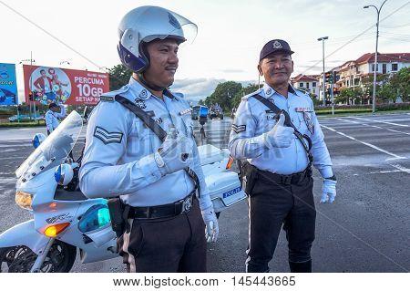 Kota Kinabalu,Sabah-Aug 31, 2016:Traffic policeman at work at Kota Kinabalu,Sabah on 31st Aug 2016 during National day parade,celebrating the 59th anniversary of independence.