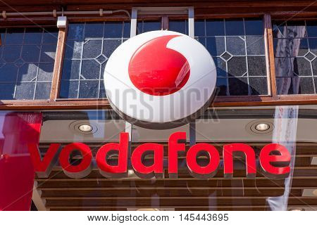 Amsterdam, The Netherlands, August 23, 2016: Vodafone logo. Vodafone Group is a British telecommunications company headquartered in London and with its registered office in Newbury, Berkshire.