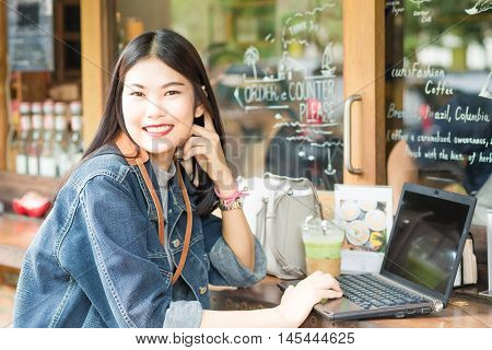 Hipster Indy Woman Using Laptop For Communications Social Networking Technology Concept