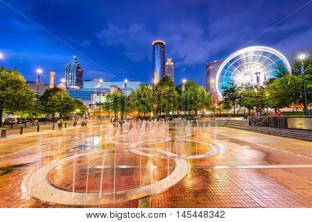 ATLANTA, GEORGIA - AUGUST 21, 2016: Visitors play in Centennial Olympic Park's landmark fountains. The Park was built for the 1996 Summer Olympics and remains a popular destination.