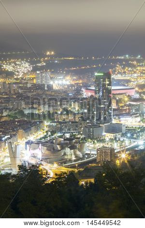 BILBAO, SPAIN - SEPTEMBER 1 2016: View of the illuminated city of Bilbao on a cloudy day. We can see the Salve bridge San Mames football stadium Iberdrola tower and the Guggenheim Museum.