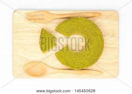 Green tea layers cake on wooden board
